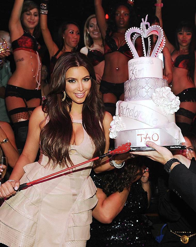 "Kim Kardashian toasted her upcoming nuptials to NBA player Kris Humphries at Tao at the Venetian in Las Vegas on Saturday, but her own party wasn't enough to keep her mind off her fiance. She and the girls surprised the guys by stopping by Kris' bachelor party and the nearby club Lavo around 2 a.m. Denise Truscello/<a href=""http://www.wireimage.com"" target=""new"">WireImage.com</a> - July 23, 2011"
