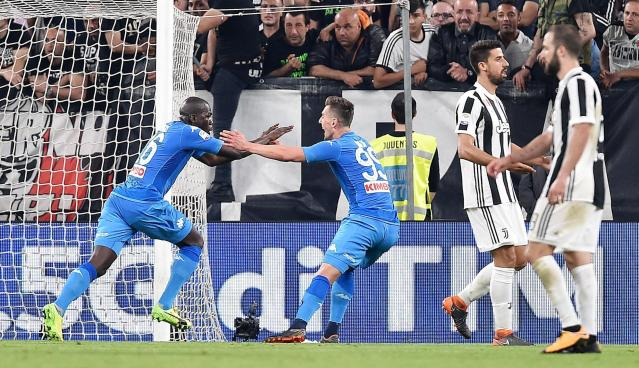 Napoli's kaliodou Koulibaly, left, celebrates after he scored during a Serie A soccer match between Juventus and Napoli at the Allianz Stadium in Turin, Italy, Sunday, April 22, 2018. (Alessandro Di Marco/ANSA via AP)