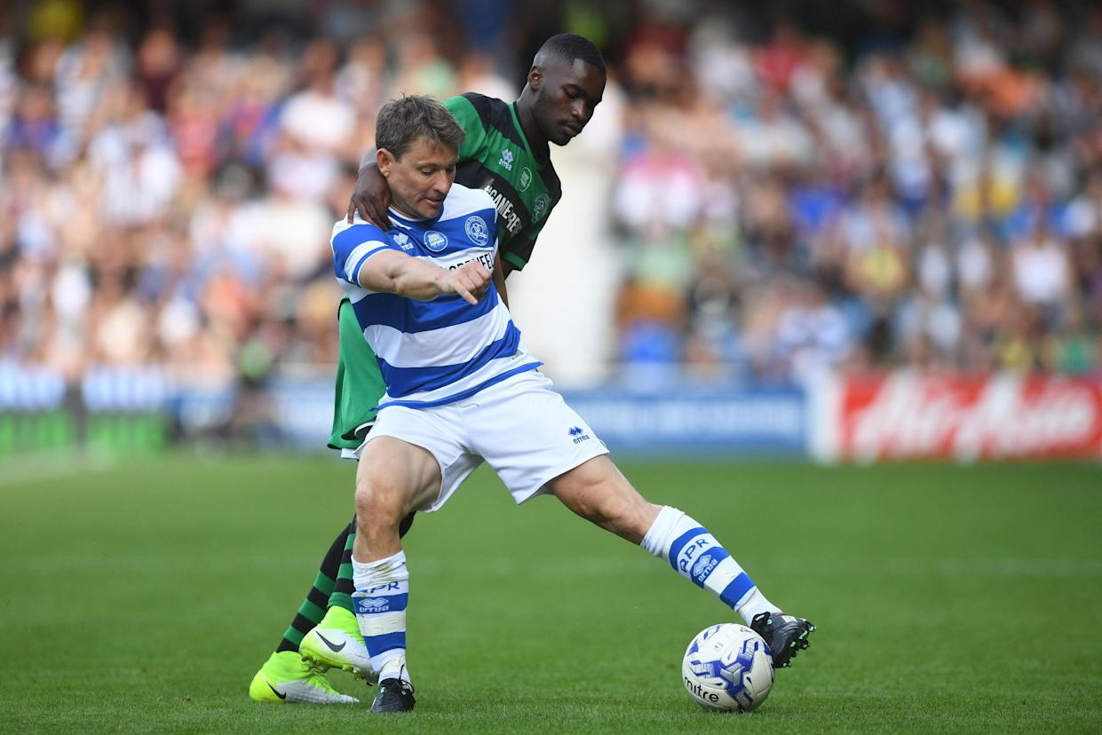 Team Ferdinand's Ben Shephard (front) and Team Shearer's DAVE battle for the ball during Game4Grenfell, a charity football match to raise funds for Grenfell Tower survivors, at QPR's Loftus Road stadium in London. (Photo by Victoria Jones/PA Images via Getty Images)