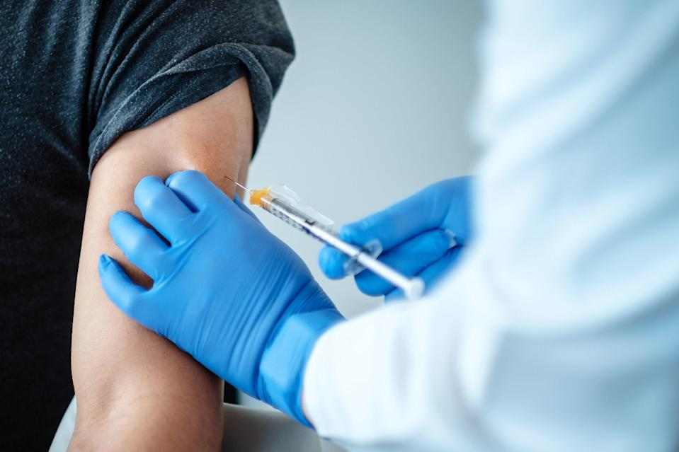 A patient being given a dose of a coronavirus vaccine produced by BioNTech (PA)