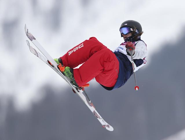 Devin Logan of the United States takes a jump during the women's freestyle skiing slopestyle final at the Rosa Khutor Extreme Park, at the 2014 Winter Olympics, Tuesday, Feb. 11, 2014, in Krasnaya Polyana, Russia. (AP Photo/Sergei Grits)