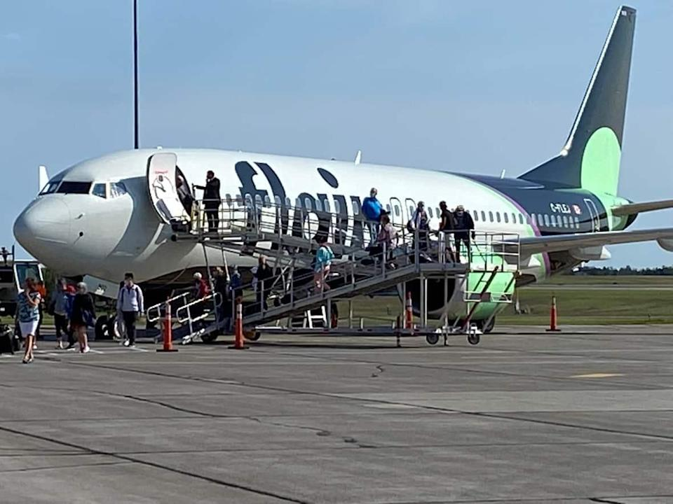 Passengers get off a Flair Airlines flight at Charlottetown Airport in August.  (Wayne Thibodeau/CBC - image credit)