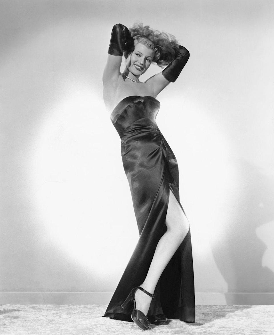 <p>Rita Hayworth in the film <em>Gilda </em>wearing a black satin gown and opera gloves. </p>