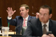 Texas State Rep. Trent Ashby, R-Lufkin, left, speaks during a hearing over an election bill at the Texas Capitol in Austin, Texas, Monday, Aug. 23, 2021. (AP Photo/Eric Gay)