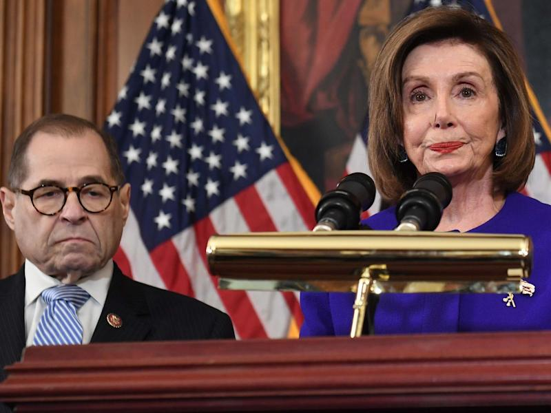 Speaker of the House Nancy Pelosi, flanked by House Judiciary chairman Jerry Nadler, announces articles of impeachment against US president Donald Trump during a press conference at the US Capitol in Washington, DC, on 10 December 2019: Saul Loeb/AFP/Getty