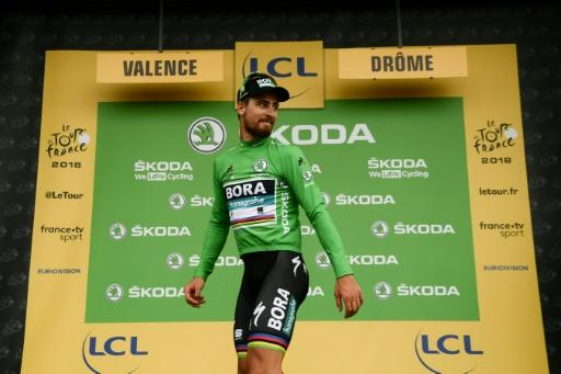 Fans' favourite: Peter Sagan wearing the green jersey for the points competition after his third stage win of the 105th Tour de France on Friday