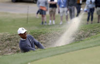 Tiger Woods plays a shot from a bunker on the 18th hole during quarterfinal play at the Dell Technologies Match Play Championship golf tournament, Saturday, March 30, 2019, in Austin, Texas. Woods lost the match to Lucas Bjerregaard. (AP Photo/Eric Gay)
