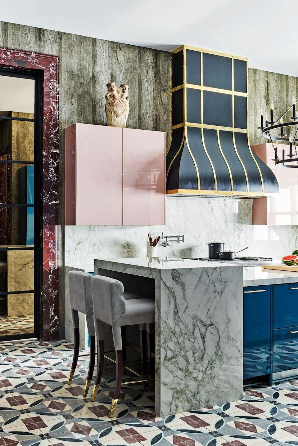 "<p>Lacquer, marble, tiles, oh my! This fabulously over-the-top kitchen designed by <a href=""http://www.michellenussbaumer.com/"" rel=""nofollow noopener"" target=""_blank"" data-ylk=""slk:Michelle Nussbaumer"" class=""link rapid-noclick-resp"">Michelle Nussbaumer</a> isn't afraid to have fun. For a similar look, choose a backsplash that corresponds with the kitchen island and then use tile on the floors.</p>"