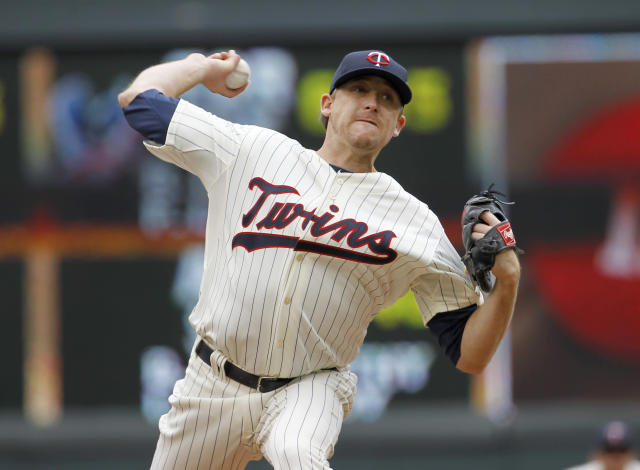 Minnesota Twins starting pitcher Kevin Correia delivers to the Baltimore Orioles during the first inning of a baseball game in Minneapolis, Saturday, May 3, 2014. (AP Photo/Ann Heisenfelt)