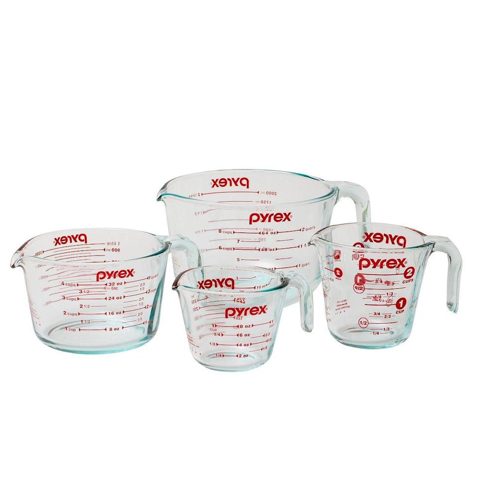 """<p><strong>Pyrex</strong></p><p>pyrexhome.com</p><p><strong>$25.00</strong></p><p><a href=""""https://www.pyrexhome.com/product/4-piece-measuring-cup-set"""" rel=""""nofollow noopener"""" target=""""_blank"""" data-ylk=""""slk:Shop Now"""" class=""""link rapid-noclick-resp"""">Shop Now</a></p><p>These measuring cups may be ones that you are very familiar with, as they are classic and have been around since 1925. The clear durable Pyrex glass makes it easy to see fluids, and the bright red print makes it a breeze to read the ounce, cup or milliliter markings. The curved spout makes pouring easy, and you don't have to worry about stains with the non-porous tempered glass that can be used in the microwave or oven. This set scored an overall 4.4 out of 5 in performance and scored a perfect score in measurement testing. What we love the most about this set is <strong>it comes with an assortment of sizes, ranging from 1-Cup to 8-Cup version. </strong>It's a favorite in the Kitchen Appliances Lab for recipe testing and getting the yield of large batches. </p><p><strong>Set includes</strong>: 1-Cup, 2-Cup, 4-Cup and 8-Cup versions</p>"""