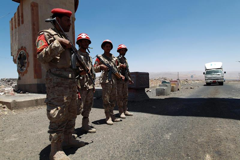 Yemeni security forces guard a checkpoint in the northwestern province of Omran, on June 9, 2014