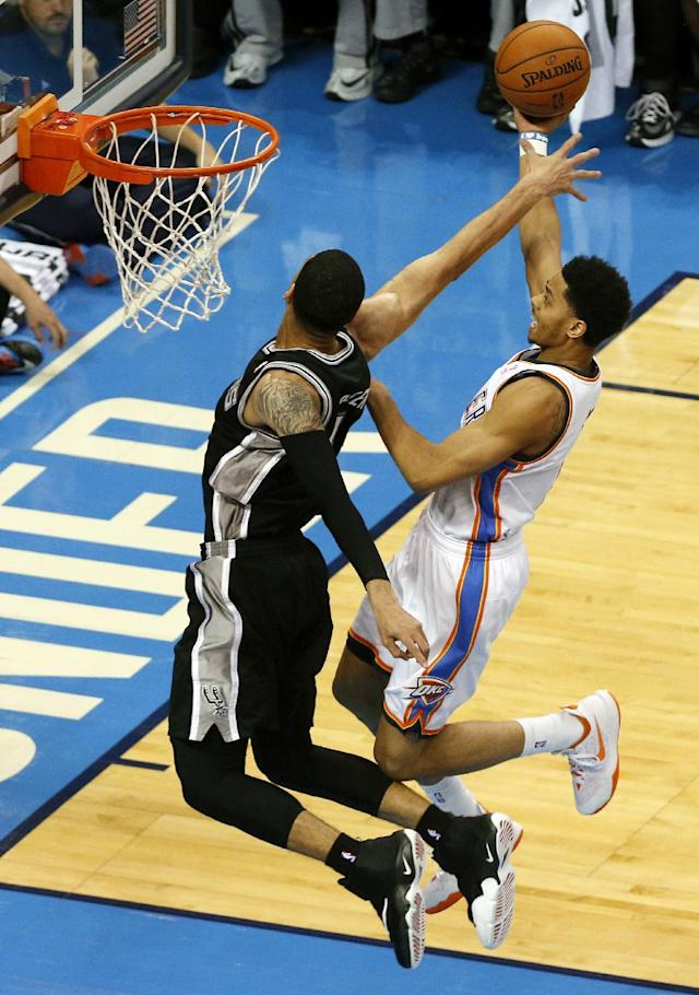 Oklahoma City Thunder guard Jeremy Lamb goes against San Antonio Spurs guard Danny Green, left, in the first half of Game 4 of the Western Conference finals NBA basketball playoff series in Oklahoma City, Tuesday, May 27, 2014. (AP Photo/Garett Fisbeck)