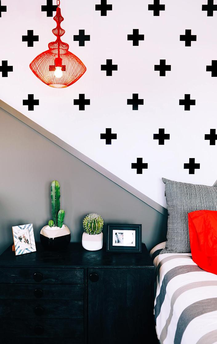 Bold wall patterns in bedroom settings.