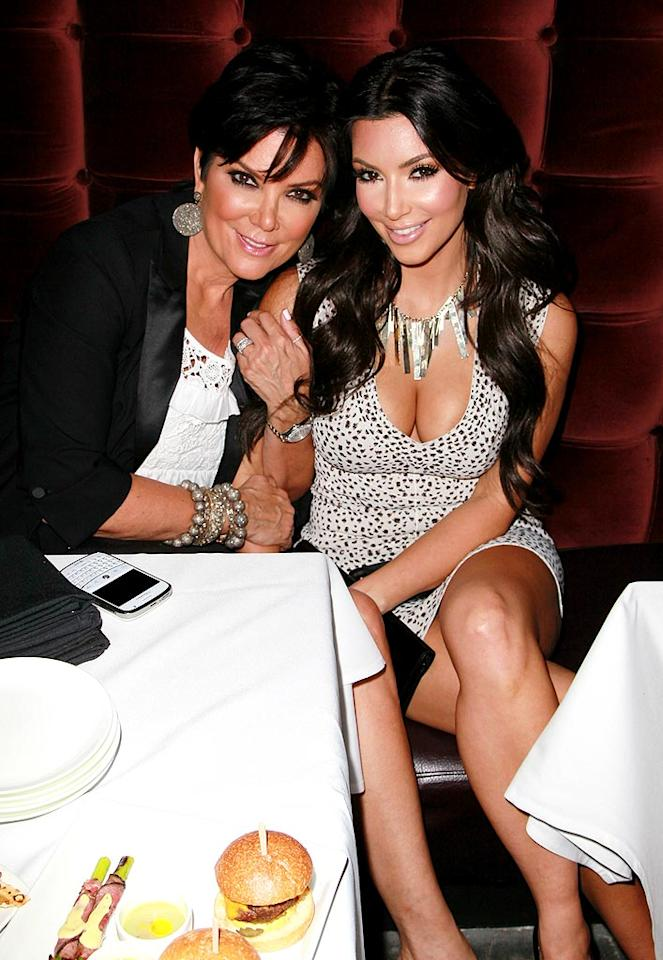 """When she's not exercising, Kim (with her mother Kris) is all about business. """"I'm totally fine not having a life,"""" she shared with <a href=""""http://ca.eonline.com/uberblog/hwood_party_girl/b175545_kim_kardashian_my_life_all_business.html"""" target=""""new"""">E! Online</a>. """"I love working."""" David Livingston/<a href=""""http://www.gettyimages.com/"""" target=""""new"""">GettyImages.com</a> - April 7, 2010"""