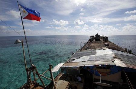 Philippine national flag flutters in wind aboard BRP Sierra Madre, run aground on disputed Second Thomas Shoal in South China Sea