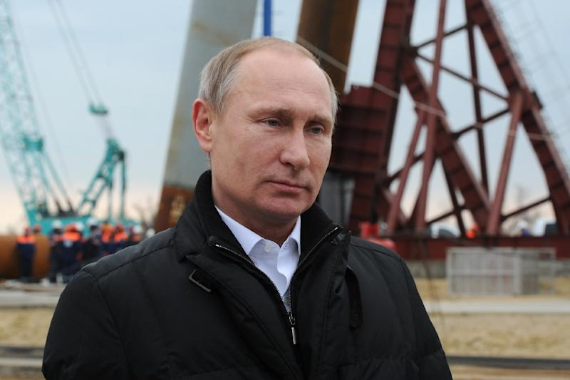 Russian President Vladimir Putin addresses people marking the second anniversary of Russia's annexation of the Black Sea peninsula in central Moscow from the site of the under-construction bridge on March 18, 2016 (AFP Photo/Mikhail Klimentyev)