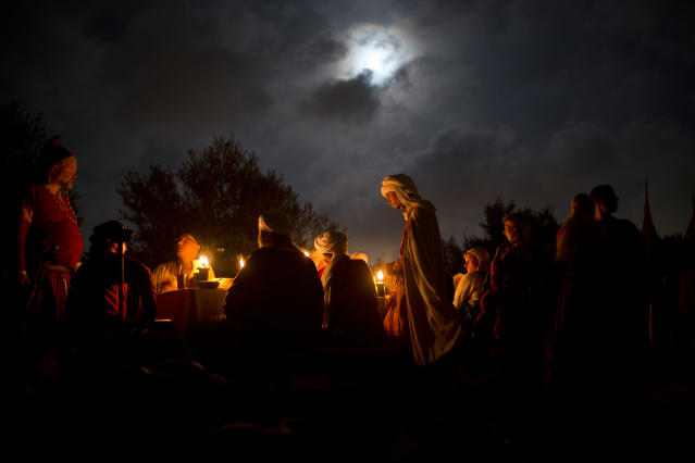 <p>Israeli and Russian members of knight clubs wearing medieval costumes eat dinner two nights before marching 27 kilometers (17 miles) to the reenactment of the Battle of Hattin from the ancient Israeli city of Zippori to Horns of Hattin, northern Israel, July 2, 2015. (Photo: Oded Balilty/AP) </p>