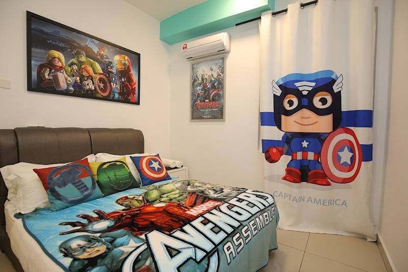 Rooms are replete with posters, figurines, and furnishings out of a comic-book fan's dream.