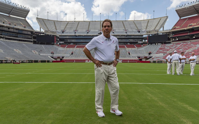Alabama head coach Nick Saban prepares for a team coach photo prior to Alabama's fall camp fan-day college football scrimmage, Saturday, Aug. 3, 2019, at Bryant-Denny Stadium in Tuscaloosa, Ala. (AP Photo/Vasha Hunt)
