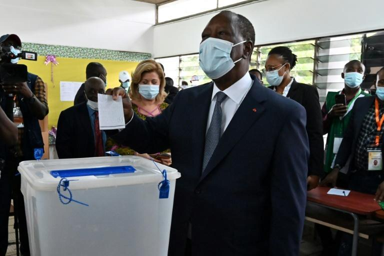 Victor: President Alassane Ouattara, casting his ballot in Abidjan on Saturday