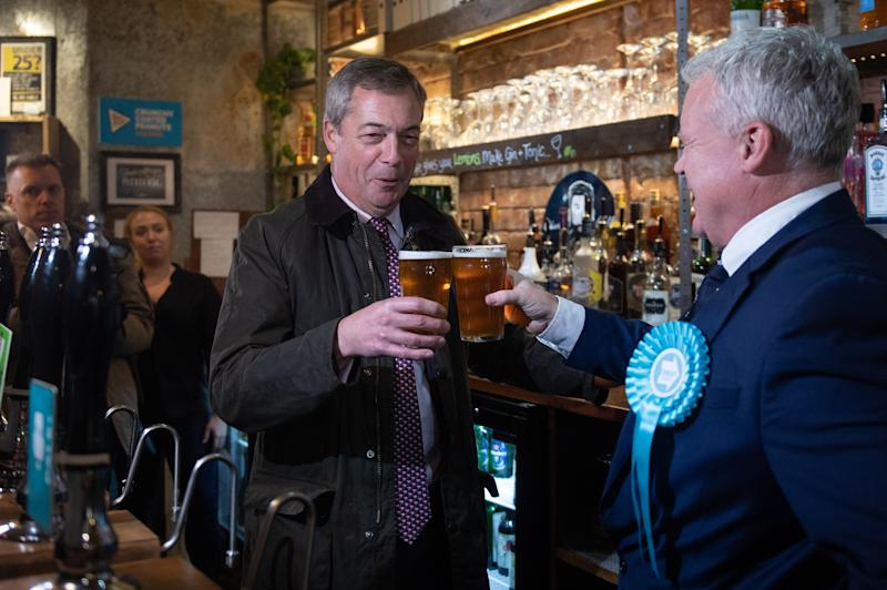 Brexit Party leader Nigel Farage and Peterborough candidate Mike Greene enjoy a pint in the Queen's Head pub during a walkabout in Peterborough, Cambridgeshire, while on the campaign trail ahead of the General Election.