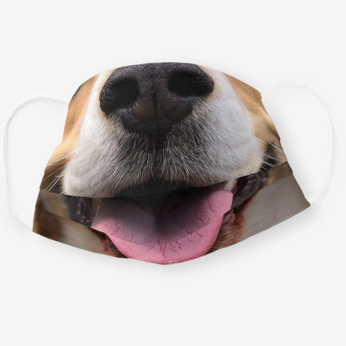 """<p>zazzle.com</p><p><strong>$12.95</strong></p><p><a href=""""https://go.redirectingat.com?id=74968X1596630&url=https%3A%2F%2Fwww.zazzle.com%2Ffunny_dog_puppy_nose_mouth_smile_muzzle_cloth_face_mask-256355856609736866&sref=https%3A%2F%2Fwww.countryliving.com%2Fshopping%2Fg33561197%2Ffunny-face-masks%2F"""" rel=""""nofollow noopener"""" target=""""_blank"""" data-ylk=""""slk:Shop Now"""" class=""""link rapid-noclick-resp"""">Shop Now</a></p><p>Now your dog can really look like its owner! </p>"""