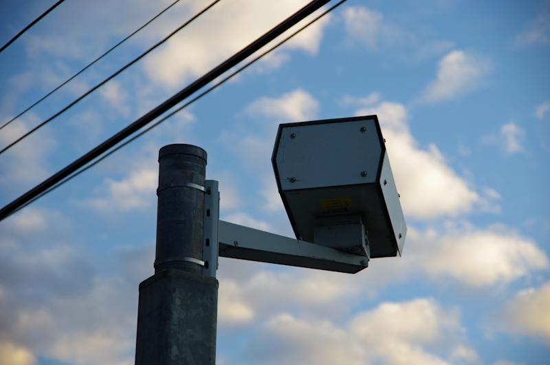 Picture of a speed camera mounted near powerlines in Australia