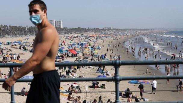 PHOTO: A man wears a face covering at the pier on the first day of the Labor Day weekend amid a heatwave on Sept. 5, 2020, in Santa Monica, Calif. (Mario Tama/Getty Images, File)