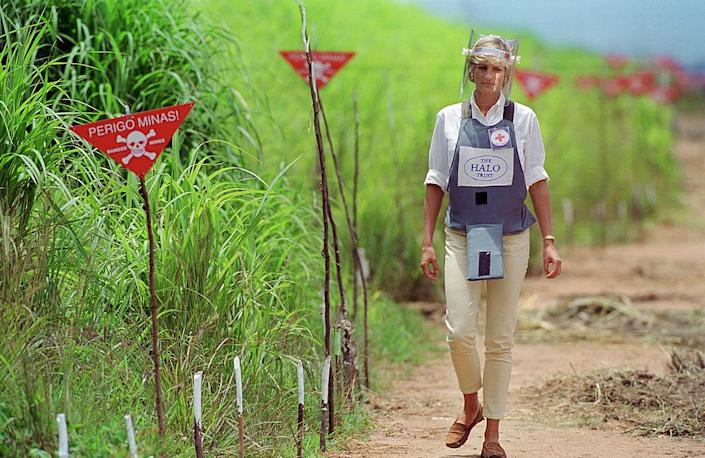 """Diana, Princess of Wales wearing protective body armour and a visor visits a landmine minefield being cleared by the charity Halo in Huambo, Angola, on Jan. 15, 1997<span class=""""copyright"""">Tim Graham Photo Library via Getty images</span>"""