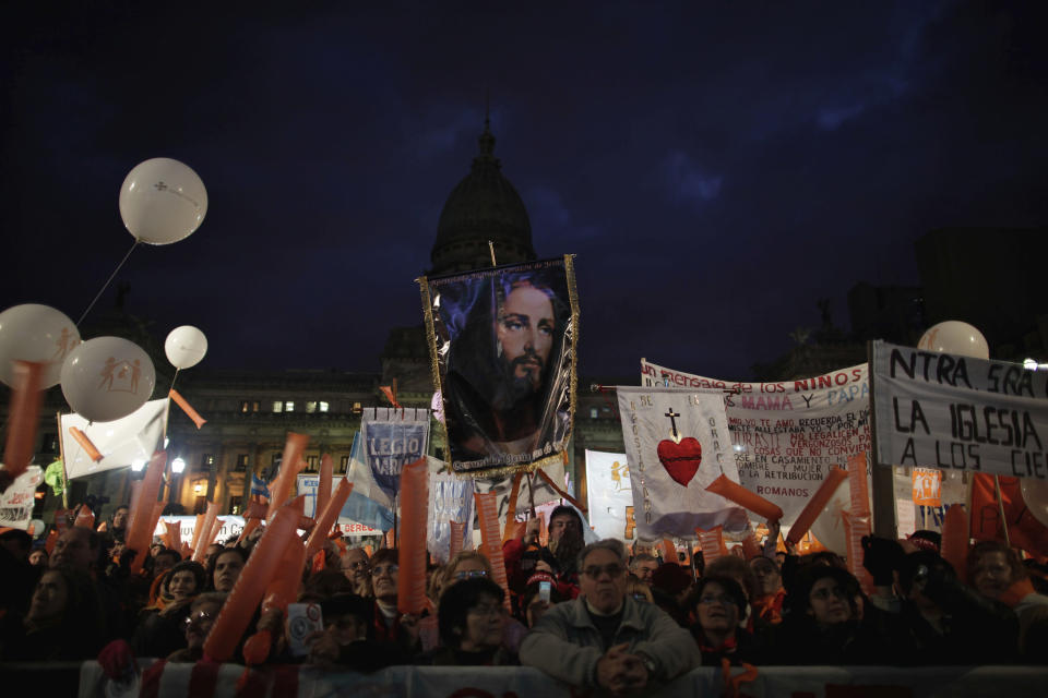 Members of Catholic groups protest outside Argentina's Congress against a same-sex marriage bill in Buenos Aires, Tuesday, July 13, 2010. Argentina subsequently became the first Latin American country to legalize same-sex marriage. (AP Photo/Natacha Pisarenko)
