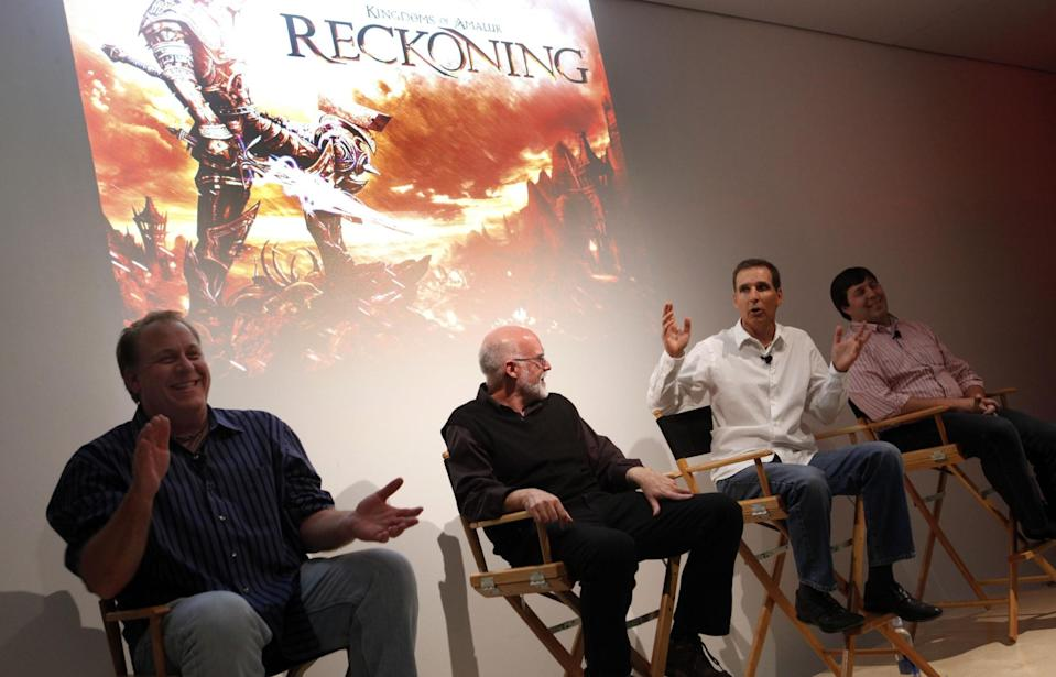 Schilling, far left, in 2011 talking at a panel for his game,