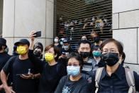 Supporters of pro-democracy activists queue up for a court hearing outside West Kowloon Magistrates' Courts, in Hong Kong
