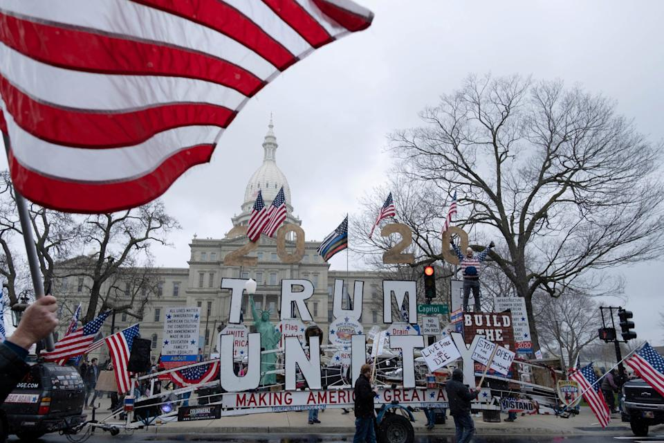 Supporters of the Michigan Conservative Coalition protest against the state's extended stay-at-home order (REUTERS)