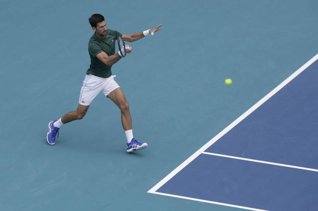 Novak Djokovic practices on center court for the Miami Open tennis tournament at Hard Rock Stadium, Monday, March 18, 2019, in Miami Gardens, Fla. The Miami Open has moved north from its home since 1987, the picturesque island of Key Biscayne, and will begin Tuesday at the home of the Miami Dolphins and the Miami Hurricanes. (AP Photo/Lynne Sladky)