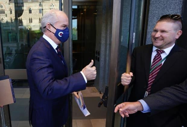 Conservative Leader Erin O'Toole gives a thumbs up as he enters a Conservative caucus meeting on Tuesday, Oct. 5, 2021 in Ottawa. (Adrian Wyld/Canadian Press - image credit)
