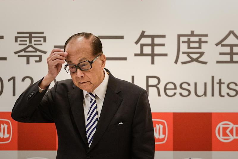 Hutchison Whampoa chairman Li Ka-shing listens to a question during a press conference in Hong Kong, on March 26, 2013