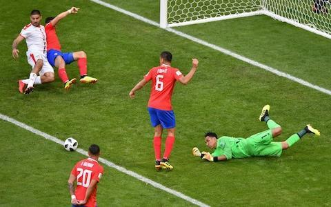 """Aleksandar Kolarov produced a moment of captain's inspiration, curling home a superb free-kick as Serbia got their Group E campaign up and running on Sunday. The former Manchester City full-back had appeared to be injured in the warm-up but recovered to curl in the winner against Costa Rica. Serbia had dominated the match but chances were at a premium until Kolarov made the breakthrough in the 56th minute. With Brazil heavy favourites to win the group, which also features Switzerland, the victory delivered a potentially vital three points for Serbia and lifted a weight from coach Mladen Krstajic, in what was his first competitive game. """"There was a great deal of pressure on the team, and on me, over the past seven months,"""" said Krstajic, who took the job in October. Krstajic's relief was matched in equal measure by the disappointment of Oscar Ramirez, the Costa Rica manager, whose side are now in a precarious position. """"Maybe we have lost a certain margin for qualifying,"""" he said. """"It's going to be difficult, but our intention remains the same. I told the lads 'This isn't over'."""" Aleksandar Kolarov struck a wonderful free-kick to win all three points for Serbia Credit: REUTERS If Costa Rica are going to recover, they will need to rediscover the defensive organisation and clinical counter-attacks that propelled them to the quarter-finals four years ago. Serbia found it hard to break them down, but they rarely looked troubled at the back and, barring a late half-chance for substitute Joel Campbell, they coasted through the game. The match began in furious fashion, with Serbia's Aleksandar Mitrovic having a header scooped off the line and Costa Rica's Giancarlo Gonzalez failing to convert two headed chances. But it soon settled into a more predictable pattern. Serbia bossed the ball as their enterprising midfield, fusing the experience of Manchester United enforcer Nemanja Matic and the raw talent of Sergej Milinkovic-Savic, got on top. Mitrovic failed to find the net """
