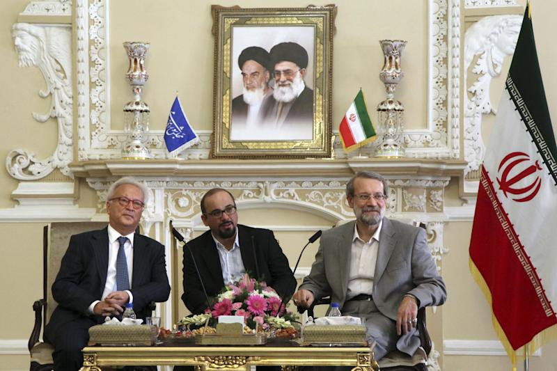 Iran's Parliament speaker Ali Larijani, right, sits with Hannes Swoboda of Austrian social democratic party during their meeting in Tehran, Iran, Sunday Oct. 20, 2013. (AP Photo/Ebrahim Noroozi)