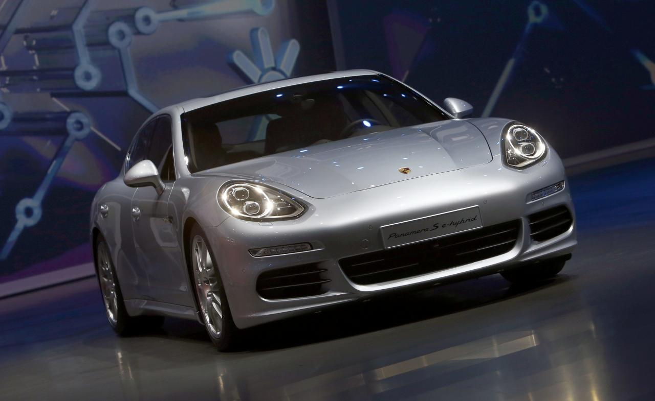The new Porsche Panamera S e-hybrid car is presented at the Volkswagen group night at the Frankfurt motor show September 9, 2013. The world's biggest auto show is open to the public September 14 -22. REUTERS/Ralph Orlowski (GERMANY - Tags: BUSINESS TRANSPORT)
