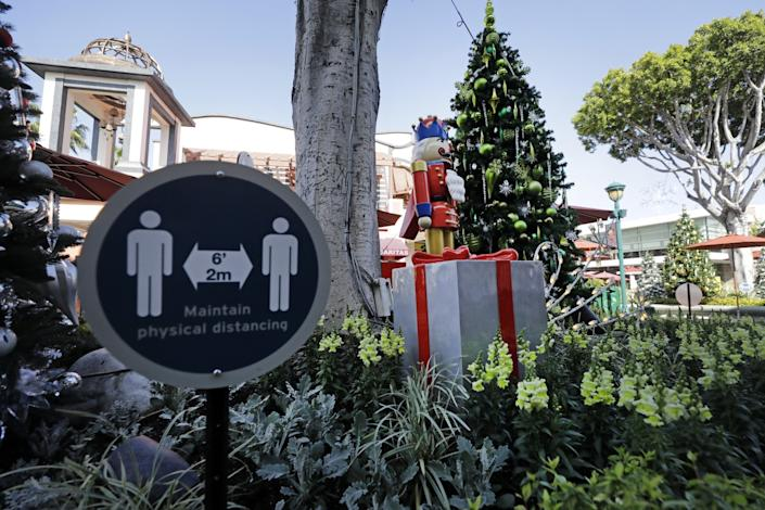 Holiday decorations and social distancing signs in the Downtown Disney District on Nov. 19 in Anaheim.