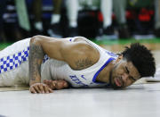 Kentucky's Nick Richards grimaces after falling to the court during the second half against Abilene Christian in a first-round game in the NCAA mens college basketball tournament in Jacksonville, Fla., Thursday, March 21, 2019. (AP Photo/Stephen B. Morton)