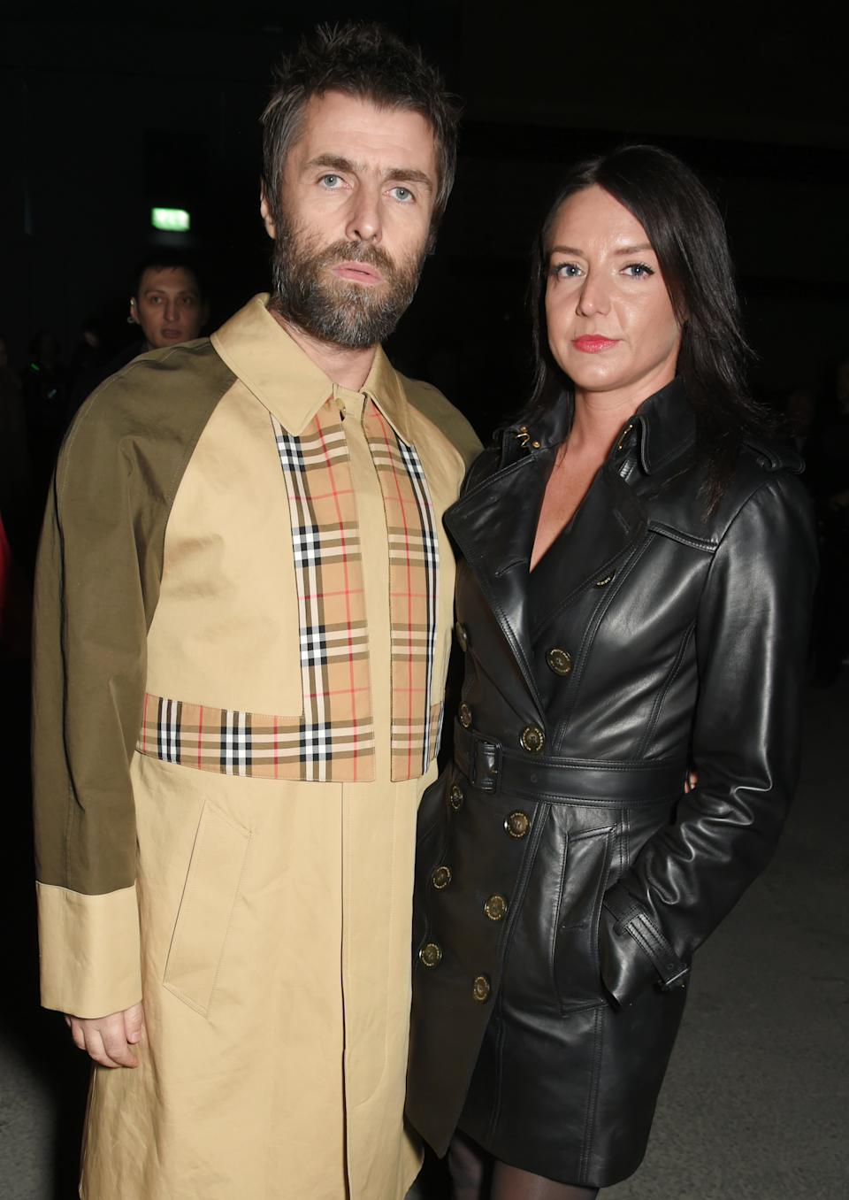 Liam Gallagher (L) and Debbie Gwyther wearing Burberry at the Burberry February 2018 show during London Fashion Week at Dimco Buildings on February 17, 2018 in London, England.  (Photo by David M. Benett/Dave Benett/Getty Images for Burberry)