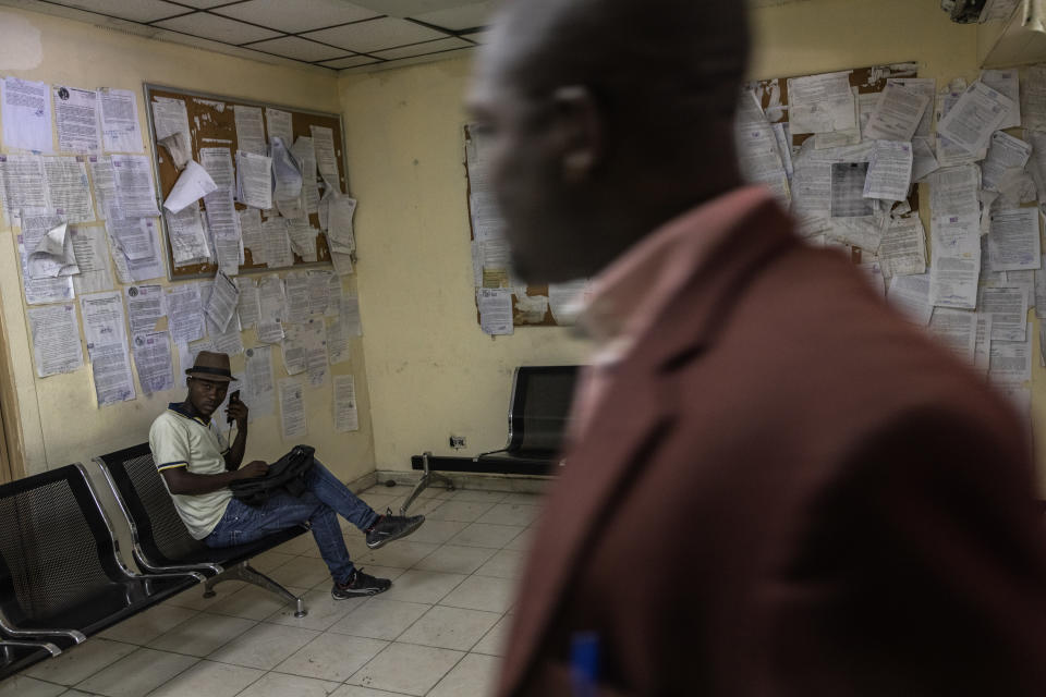 An employee sits inside the Justice of Palace, in Port-au-Prince, Haiti, Thursday, Sept. 16, 2021. Even before the assassination of President Jovenel Moise in July, the government was weak -- the Palace of Justice inactive, congress disbanded by Moise and the legislative building pocked by bullets. (AP Photo/Rodrigo Abd)