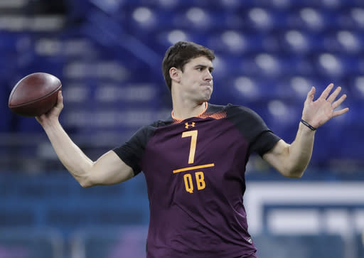 FILE - In this March 2, 2019, file photo, Duke quarterback Daniel Jones runs a drill at the NFL football scouting combine in Indianapolis. Jones is a possible pick in the 2019 NFL Draft. (AP Photo/Michael Conroy, File)