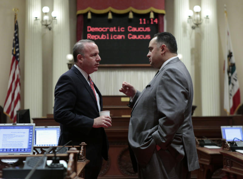 CORRECTS DATE TO FRIDAY, JUNE 15, NOT THURSDAY, JUNE 14- State Senate President Pro Tem Darrell Steinberg, D-Sacramento, left, confers with Assembly Speaker John Perez, D-Los Angeles, as the Senate members caucused at the Capitol in Sacramento, Calif., Friday, June, 15, 2012. The Senate approved the budget plan by a 23-16 vote and sent it to the Assembly.(AP Photo/Rich Pedroncelli)