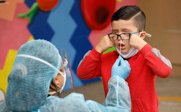 Kindergarten student Matteo Rodriguez gets a Covid-19 test in California (Al Seib / Los Angeles Times via Getty Images)