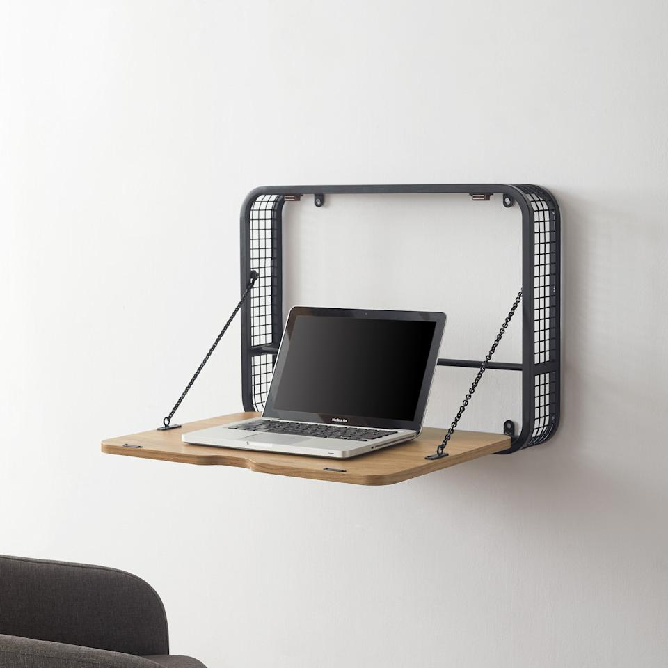 """<h3>Manor Park Industrial Fold-Up Desk</h3><br>Another wall-mounted style that showcases workspace minimalism at its finest. <br><br><strong>Manor Park</strong> Industrial Fold Up Desk, English Oak, $, available at <a href=""""https://go.skimresources.com/?id=30283X879131&url=https%3A%2F%2Fwww.walmart.com%2Fip%2FManor-Park-Industrial-Fold-Up-Desk-English-Oak%2F298018634"""" rel=""""nofollow noopener"""" target=""""_blank"""" data-ylk=""""slk:Walmart"""" class=""""link rapid-noclick-resp"""">Walmart</a>"""