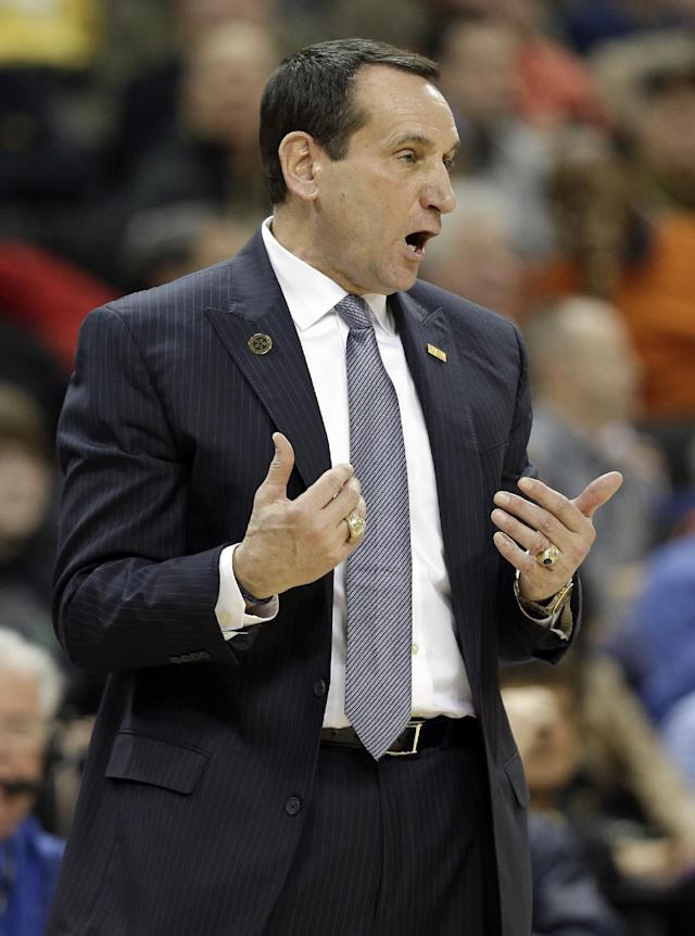 In this photo taken Wednesday, March 5, 2014, Duke head coach Mike Krzyzewski argues a call during the first half of an NCAA college basketball game against Wake Forest in Winston-Salem, N.C. Coach Krzyzewski is out of the hospital after feeling light-headed after a loss at Wake Forest. The school said in a statement Thursday, March 6, that Krzyzewski was taken to Duke University Hospital in Durham for a precautionary examination after the 82-72 loss in Winston-Salem.(AP Photo/Chuck Burton)