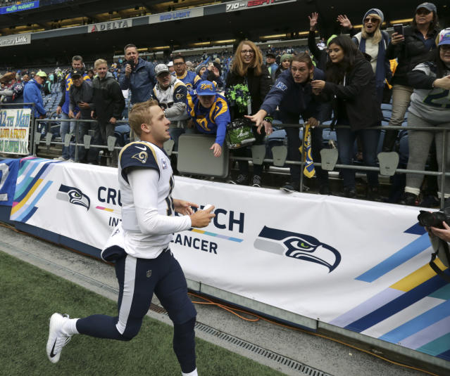 Los Angeles Rams quarterback Jared Goff runs to greets fans after an NFL football game against the Seattle Seahawks, Sunday, Oct. 7, 2018, in Seattle. (AP Photo/Scott Eklund)