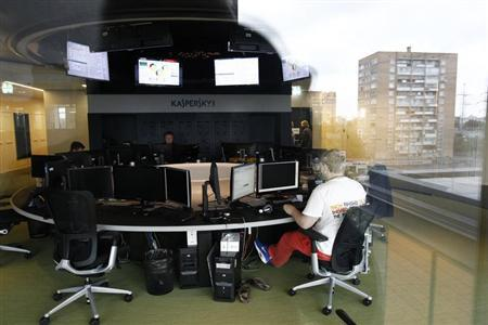 An employee works near screens in the virus lab at the headquarters of Russian cyber security company Kaspersky Labs in Moscow